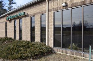 Photo of the front of the building for Minuteman Press at 1 Anngina Drive